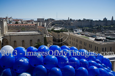 Helium filled balloons are ready for release above the Old City walls following a press conference lead by Mayor Nir Barkat. Jerusalem, Israel. 4-Feb-2013.  Jerusalem Mayor Nir Barkat holds a press conference on the rooftop of the Mamilla Hotel, overlooking the Old City and many of the city's famous icons, on the upcoming 3rd Jerusalem International Marathon to take place March 1st.