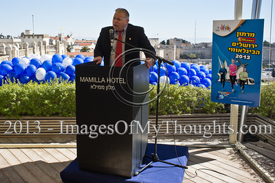 Jerusalem Councilman and Sports Portfolio Administrator, Elisha Peleg, briefs the press on the March 1st planned Jerusalem International Marathon. Jerusalem, Israel. 4-Feb-2013.  Jerusalem Mayor Nir Barkat holds a press conference on the rooftop of the Mamilla Hotel, overlooking the Old City and many of the city's famous icons, on the upcoming 3rd Jerusalem International Marathon to take place March 1st.