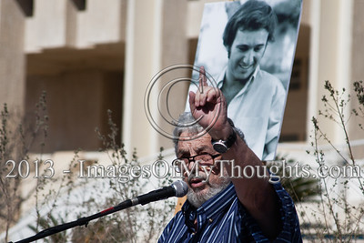 "A speaker stands below an enlarged photo of murdered peace activist Emil Grunzweig at a 30-year commemoration ceremony. Jerusalem, Israel. 10-Feb-2013.  ""Peace Now"" leads a 30-year commemoration ceremony for activist Emil Grunzweig, murdered in 1983 by a grenade thrown by right-wing activist Yona Avrushmi at demonstrators calling for the resignation of Defense Minister Ariel Sharon."