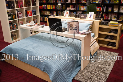 A bookstand at the Jerusalem International Book Fair displays a bedroom setup suggesting reading in bed. Jerusalem, Israel. 10-Feb-2013.  First held in 1963, the Jerusalem International Book Fair is a unique biennial event, business fair and a prestigious and important cultural event. 600 publishers and authors from more than 30 countries display more than 100,000 books.