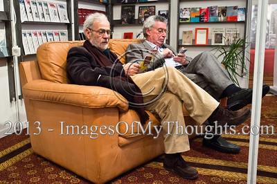 Two men relax on a couch at the Jerusalem International Book Fair. Jerusalem, Israel. 10-Feb-2013.  First held in 1963, the Jerusalem International Book Fair is a unique biennial event, business fair and a prestigious and important cultural event. 600 publishers and authors from more than 30 countries display more than 100,000 books.