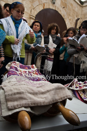 Women of the Wall continue their month of Adar celebration in a prayer service and Torah reading near the Kishle police station where they believe 10 of their detained friends are being held for questioning. Jerusalem, Israel. 11-Feb-2013.  Morning prayers celebrating the month of Adar were conducted today on the women's side of the Kotel by Women of The Wall, in defiance of rulings forbidding them to pray in the manner of orthodox men. Ten were detained by police for questioning.