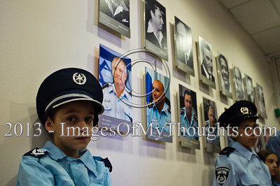 Excited children, dressed up for Purim as policemen and policewomen, wait to enter the Israel Police Commissioner's meeting room and meet Commissioner Yohanan Danino. Jerusalem, Israel. 25-Feb-2013.  Children of policemen, in Purim police costumes, man the positions of the Israel Police High Command at the National HQ. Purim, one of Judaism's more colorful holidays, commemorates the miraculous salvation of the Jews from a Persian genocidal plot.