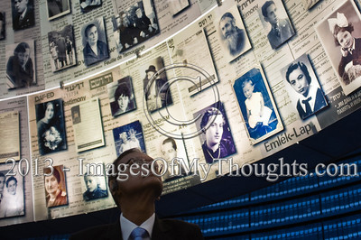 Professor Gamini Lakshman Peiris, External Affairs Minister of Sri Lanka, gazes up at enlarged Pages of Testimony displayed on the cone-shaped ceiling of the Hall of Names at Yad Vashem Holocaust Museum. Jerusalem, Israel. 26-Feb-2013.  The Minister of External Affairs of Sri Lanka, Prof. G.L. Peiris, visits Yad Vashem Holocaust Museum. The Minister toured the museum, participated in a memorial ceremony and signed the museum guest book.