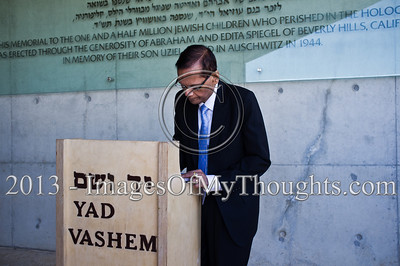 Coming out of the Children's Memorial Hall, Professor Gamini Lakshman Peiris, External Affairs Minister of Sri Lanka, signs the guest book at Yad Vashem Holocaust Museum. Jerusalem, Israel. 26-Feb-2013.  The Minister of External Affairs of Sri Lanka, Prof. G.L. Peiris, visits Yad Vashem Holocaust Museum. The Minister toured the museum, participated in a memorial ceremony and signed the museum guest book.