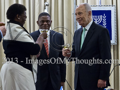 President of the State of Israel, Shimon Peres, Mr. Sisa Ngombane, Republic of South Africa Ambassador to Israel and Ambassador's wife raise a toast to the Ambassador's success. Jerusalem, Israel. 28-Feb-2013.  Mr. Sisa Ngombane, newly appointed Republic of South Africa Ambassador to Israel, presented his Letter of Credence to the President of the State of Israel, Shimon Peres, in a formal ceremony at the President's Residence.