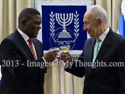 President of the State of Israel, Shimon Peres and Mr. Sisa Ngombane, Republic of South Africa Ambassador to Israel, raise a toast to the Ambassador's success. Jerusalem, Israel. 28-Feb-2013.  Mr. Sisa Ngombane, newly appointed Republic of South Africa Ambassador to Israel, presented his Letter of Credence to the President of the State of Israel, Shimon Peres, in a formal ceremony at the President's Residence.