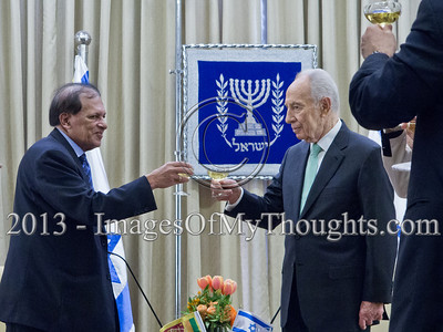 President of the State of Israel, Shimon Peres and Mr. Sarath Devesena Wijesinghe, Democratic Socialist Republic of Sri Lanka Ambassador to Israel, raise a toast to the Ambassador's success. Jerusalem, Israel. 28-Feb-2013.  Mr. Sarath Devesena Wijesinghe, newly appointed Democratic Socialist Republic of Sri Lanka Ambassador to Israel, presented his Letter of Credence to the President of the State of Israel, Shimon Peres, in a formal ceremony at the President's Residence.