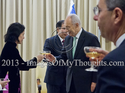 President of the State of Israel, Shimon Peres and Mr. Ta Duy Chinh, Socialist Republic of Vietnam Ambassador to Israel, and the Ambassador's wife raise a toast to the Ambassador's success. Jerusalem, Israel. 28-Feb-2013.  Mr. Ta Duy Chinh, newly appointed Socialist Republic of Vietnam Ambassador to Israel, presents his Letter of Credence to the President of the State of Israel, Shimon Peres, in a formal ceremony at the President's Residence.