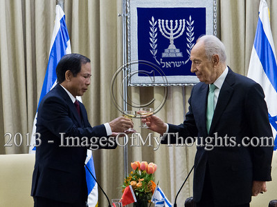 President of the State of Israel, Shimon Peres and Mr. Ta Duy Chinh, Socialist Republic of Vietnam Ambassador to Israel, raise a toast to the Ambassador's success. Jerusalem, Israel. 28-Feb-2013.  Mr. Ta Duy Chinh, newly appointed Socialist Republic of Vietnam Ambassador to Israel, presents his Letter of Credence to the President of the State of Israel, Shimon Peres, in a formal ceremony at the President's Residence.