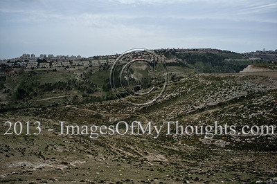 A view towards Maale Adumim from the Mevaseret Adumim neighborhood in disputed E1 in which construction is frozen since 2009 under international pressure on the Israeli government. Mevaseret Adumim, Israel. 4-March-2013.  E1 area is an obstacle to be overcome in any future peace accord between Israel and the Palestinians. E1 may either determine a continuous Israeli population between Jerusalem and Maale Adumim or a contiguous Palestinian state from North to South.