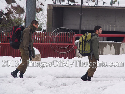 IDF soldiers make their way home by foot for weekend furlough after massive overnight snowfall brought by snowstorm Alexa brings the capital to a halt. Hundreds of stranded drivers rescued overnight and tens of thousands remain without electricity. Public transportation is non-existent.