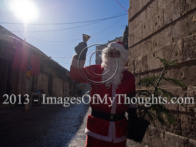 Santa Claus distributes Christmas trees at Jerusalem's New Gate