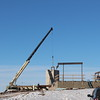 Steel beams for the Rangeland Complex lab building are moved into place by a crane Jan. 15, 2015. (Courtesy photo).