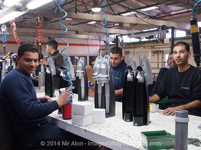 Feb. 2, 2014 - Mishor Adumim, West Bank - Jews and Arabs work side by side at the Mishor Adumim, West Bank, SodaStream plant. The Boycott, Divestment and Sanctions (BDS) movement has been leading a campaign against SodaStream (NASDAQ SODA), Israeli manufacturer of carbonated drink machines, with one of twenty two plants in the West Bank. Employment at SodaStream Mishor Adumim plant comprised of Palestinian Arabs, Israeli Arabs, and Israeli Jews, building bridges between Israelis and Palestinians.