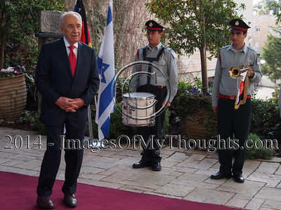 Israeli President SHIMON PERES confers the Presidential Medal of Distinction upon Chancellor ANGELA MERKEL for her 'unwavering commitment to Israel's security and the fight against anti-Semitism'. The medal, awarded for unique and outstanding contributions to 'Tikkun Olam', bettering the world, the highest civilian award in Israel, was previously bestowed upon U.S. Presidents Clinton and Obama.
