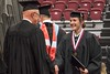 Megan McLean shakes hands with Gary Beganski, NSCS board member, during Chadron State College undergraduate commencement Friday, Dec. 16, 2016. (Photo by Tena L. Cook/Chadron State College)