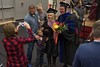 Stephanie Buckman-King takes a photo of her daughter, Taylor Schommer, and other family members during the Chadron State College undergraduate commencement Dec. 16, 2016, at the Chicoine Center. (Photo by Tena L. Cook/Chadron State College)