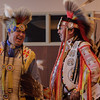 Tyler Yellow Boy of Ogallala, Nebraska, left, and Sheldon Two Crow of Wanblee, South Dakota, right, celebrate with attendees of the annual CSC Powwow at Chadron State College Nov. 19, 2016, hosted by the Native American Club. (Photo by Conor Casey/CSC)