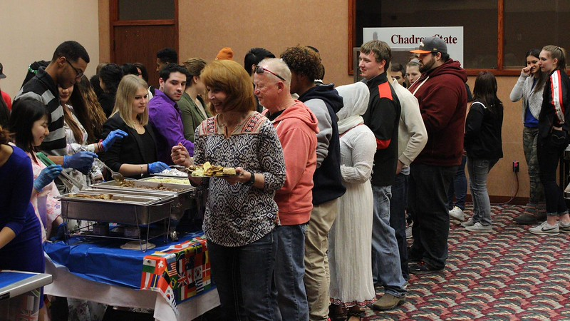 Attendees at the International Food Tasting event enjoy different homemade dishes from various cultures March 19, 2016, in the Chadron State College Student Center. (Photo by Alex Coon/Chadron State College)
