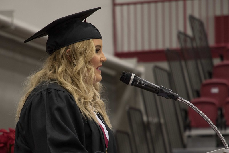 Alyssa Sanders presents the closing moment of reflection at the Chadron State College undergraduate commencement in the Chicoine Center Friday, Dec. 16, 2017. (Photo by Tena L. Cook/Chadron State College)