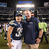 Chadron State College alumni Danny Woodhead and Chris Carlisle pose for a photo following an NFL preseason game in Seattle. Carlisle will be the Chadron State College undergraduate commencement speaker May 7, 2016. (Photo Courtesy of Rod Mar).