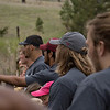 Members of the Chadron State College football team and The Big Event volunteers listen intently to tree planting instructions by Chadron State Park personnel and volunteers April 23, 2016, before planting 800 trees in the park. (Tena L. Cook/Chadron State College)