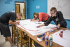 Chadron State College students who are members of Unified paint their club's bed sheet Tuesday, Sept. 27, 2016, in the King Library in preparation for the annual Homecoming competition next week. (Photo by Tena L. Cook/Chadron State College)