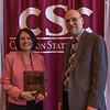 Frances Gonzalez, honored retiree, and Dr. Charles Snare at the annual Chadron State College Faculty and Staff Recognition Luncheon April 14, 2016. (Tena L. Cook/Chadron State College)