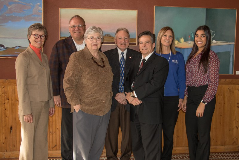 "Nebraska Business Development Center staff pose at the Bean Broker during a ""Get to Know You"" tour of client businesses Tuesday, Nov. 29, 2016. Back row, from left, Cathy Lang, incoming state director, Bob Bernier, outgoing state director, Lou Pol, dean of University of Nebraska-Omaha college of business administration, Jean Waters, deputy state director, and Erika Roybal, graduate assistant from the Chadron office. Front row, from left, Jennifer Wittrock and Gary Dusek from the Chadron office. (Photo by Tena L. Cook/Chadron State College)"