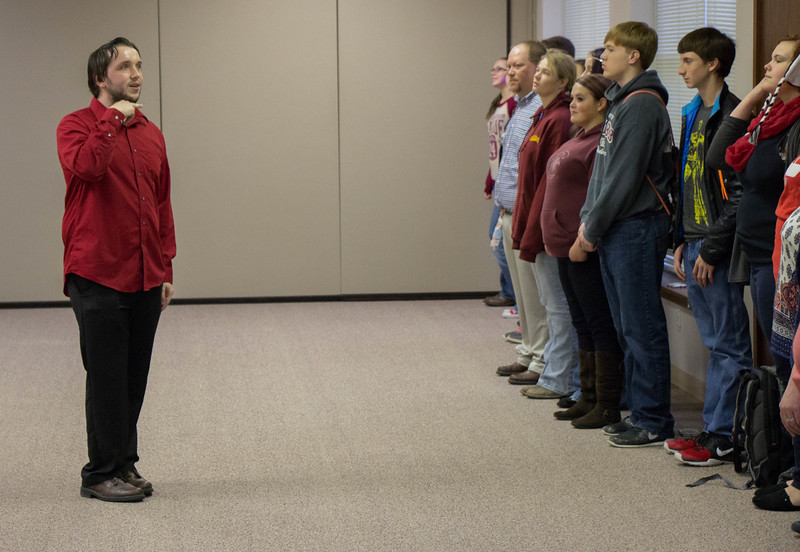 Laven Adair of Hot Springs, South Dakota, teaches attendees of Chadron State College's Theatre Day how to adopt an alternate persona in the Ponderosa Room of the Student Center.  (Photo by Conor Casey/CSC)