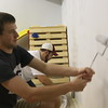 Kaly Lytle and Austin Stevens paint the walls at the College Heights Academy. (Photo by Alex Coon/CSC)