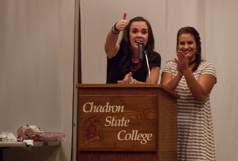 Katie O'Boyle of Gering, Nebraska, and Gabriela Perez of Sioux City, Iowa, host the 2016 homecoming coronation in the Chadron State College Student Center Ballroom, Oct. 5,  2016. (Photo by Conor Casey/CSC)