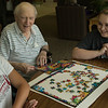 Sam Rahmig of Gering, Neb., left, and Tristan Loyd of Casper, Wyo., right, visit with Crest View Care Center resident Don Housh, center, as part of The Big Event Saturday, April 23, 2016. (Tena L. Cook/Chadron State College)