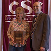 Kathy Mason, honored retiree, and Dr. Charles Snare at the annual Chadron State College Faculty and Staff Recognition Luncheon April 14, 2016. (Tena L. Cook/Chadron State College)