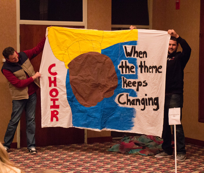 Alex Helmbrecht, director of College Relations, and Austen Stephens, associate director of housing and resident life, display the Choir department's winning bed sheet in the Student Center ballroom, as part of homecoming coronation, Oct. 5, 2016. (Photo by Conor Casey/CSC)