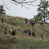 Members of the Chadron State College football team spread out over the hills in Chadron State Park planting a total of 800 trees April 23, 2016, during the fourth annual The Big Event. (Tena L. Cook/Chadron State College)