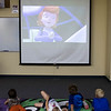 """Children enrolled at the Chadron State College Child Development Center watch an episode of """"Ready, Jet, Go"""" on Tuesday, June 14, 2016, one of four NET events in Chadron during a tour of western Nebraska. (Photo by Tena L. Cook/Chadron State College)"""