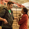 The petting zoo in the Coffee Agriculture Pavilion was a popular feature during Spring Daze Saturday. From left, Zachary Banzhaf and Nikki Banzhaf. (Photo by Tena L. Cook/Chadron State College)