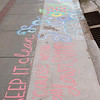 Sidewalk art by the Chadron State College volleyball team near the Dawes County Courthouse helped communicate a message from Keep Chadron Beautiful related to Earth Day during Chadron State College's fourth annual The Big Event April 23, 2016. (Tena L. Cook/Chadron State College)