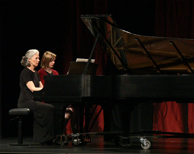 Una Taylor, music professor, left and Kallie Bush perform a musical piece at the spring Keyboard Ensemble in Memorial Hall, May 3, 2016. (Photo by Conor Casey/CSC)