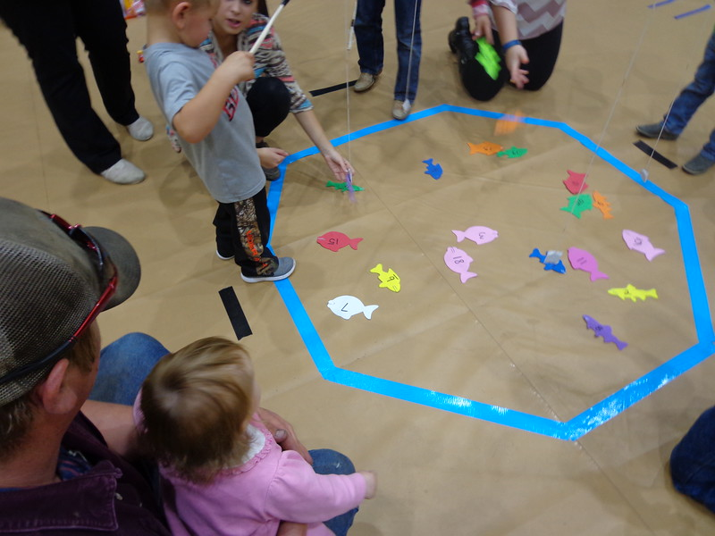 Dayton Young participates in a fishing game at Family Math Night in Hay Springs, Nebraska in 2013. (Courtesy photo)