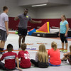 Olufemi Aaron of Pasadena California instructs elementary students participating in Kids Fitness and Nutrition Day on staying active with fun games in the Nelson Physical Activities Center. (Photo by Conor Casey/CSC)