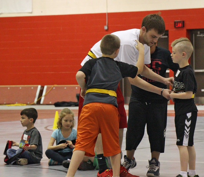 Slade Hunn of Chadron, Nebraska, helps kids put on flags for  Challenge Days in the Nelson Physical Activities Center. (Photo by Conor Casey/CSC)
