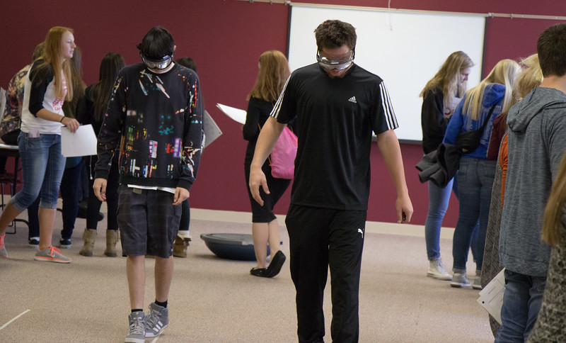 Attendees of the Health Professions Showcase try their hand at walking a straight line with drunk goggles on in the Student Center, Oct. 20, 2016. (Photo by Conor Casey/Chadron State College)