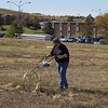 Lucinda Mays, Chadron State grounds supervisor, plows in blue stem grass seed by CSC's living fence along 10th Street, Oct. 20 2016.  (Photo by Conor Casey/Chadron State College)