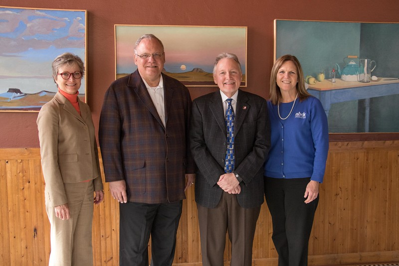 "Nebraska Business Development Center staff pose at the Bean Broker during a ""Get to Know You"" tour of client businesses Tuesday, Nov. 29, 2016. From left, Cathy Lang, incoming state director, Bob Bernier, outgoing state director, Lou Pol, dean of University of Nebraska-Omaha college of business administration, and Jean Waters, deputy state director. (Photo by Tena L. Cook/Chadron State College)"