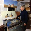 Local artist Robin Smith compares two of his paintings, a landscape and a still life designed to mimic it. His show will be in the Mari Sandoz High Plains Heritage Center May 30-Aug. 12, 2016. (George Ledbetter photo)