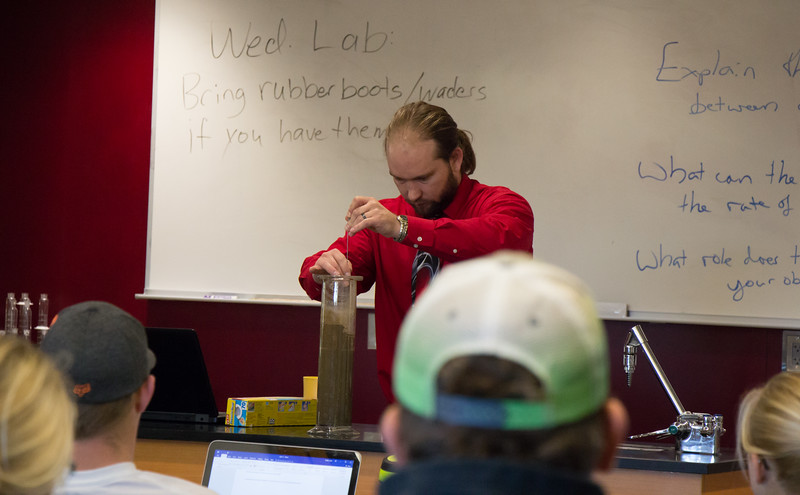 Anthony Perlinski , assistant professor of Applied Sciences, instructs students in soil saturation in the new lab in the Rangeland Lab, Oct. 24, 2016.  (Photo by Conor Casey/Chadron State College)