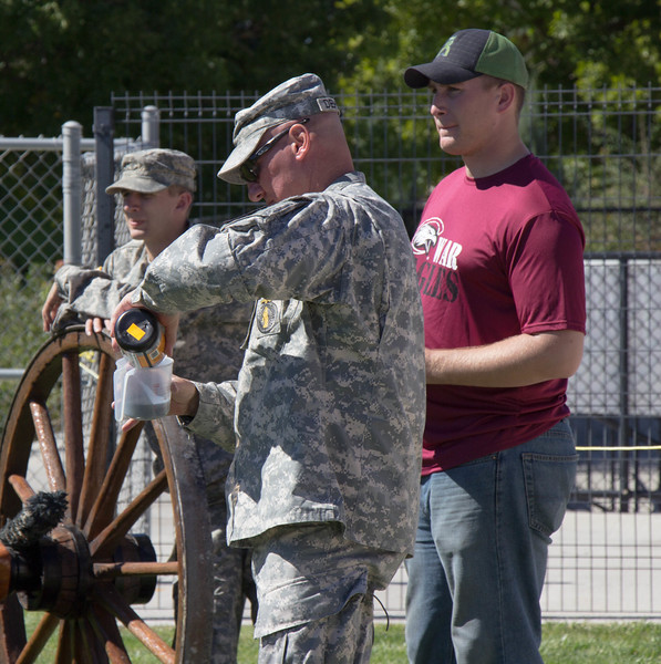 Members of the National Guard prepare the cannon at Don Beebe Memorial Stadium during Family Day, Sept. 17 2016. (Photo by Conor Casey/CSC)